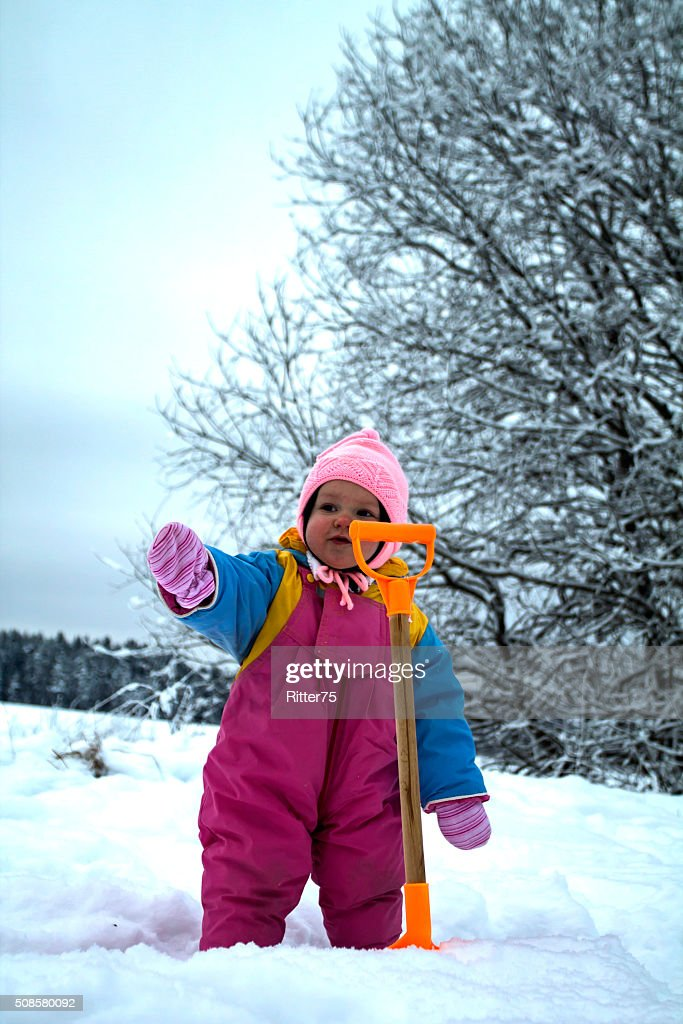 Little Baby by Toy Spade in Winter : Stock Photo