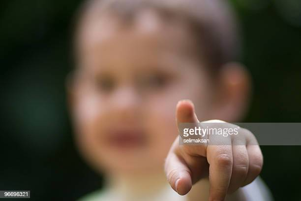 Little Baby Pointing Directly At Camera