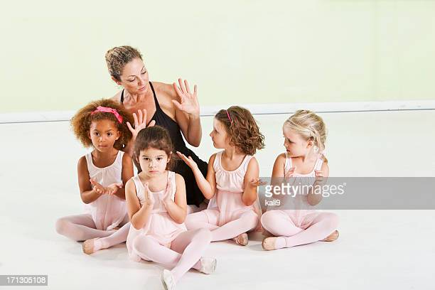 Little ballerinas with dance teacher