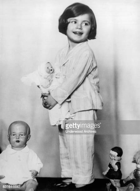 Little Baroness Anna Soragno holds a doll presented to her by the Crown Princess of Italy Rome Italy June 1930 At left is a doll from the Crown...