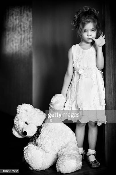 Little beautiful girl with a favorite teddy bear