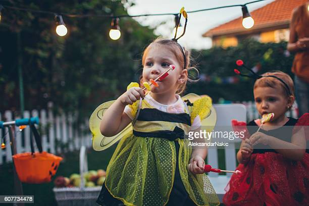 Little bee and lady bug having some Halloween candy