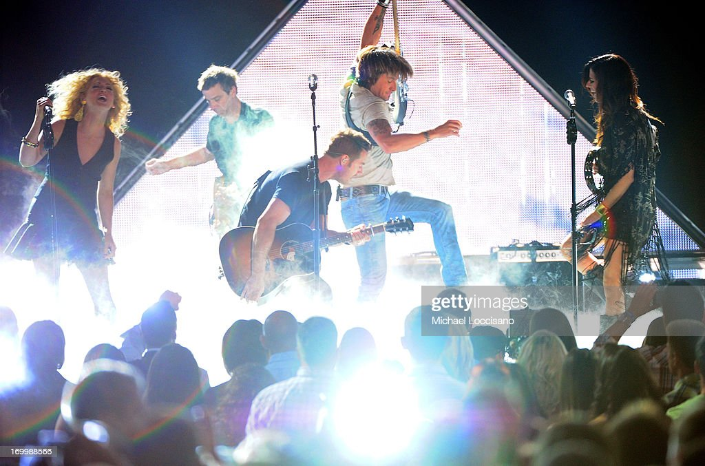 Little Big Town and Keith Urban perform during the 2013 CMT Music awards at the Bridgestone Arena on June 5, 2013 in Nashville, Tennessee.