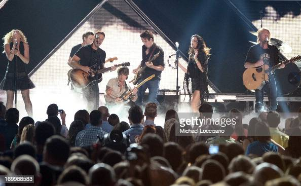 Little Big Town and Keith Urban perform during the 2013 CMT Music awards at the Bridgestone Arena on June 5 2013 in Nashville Tennessee