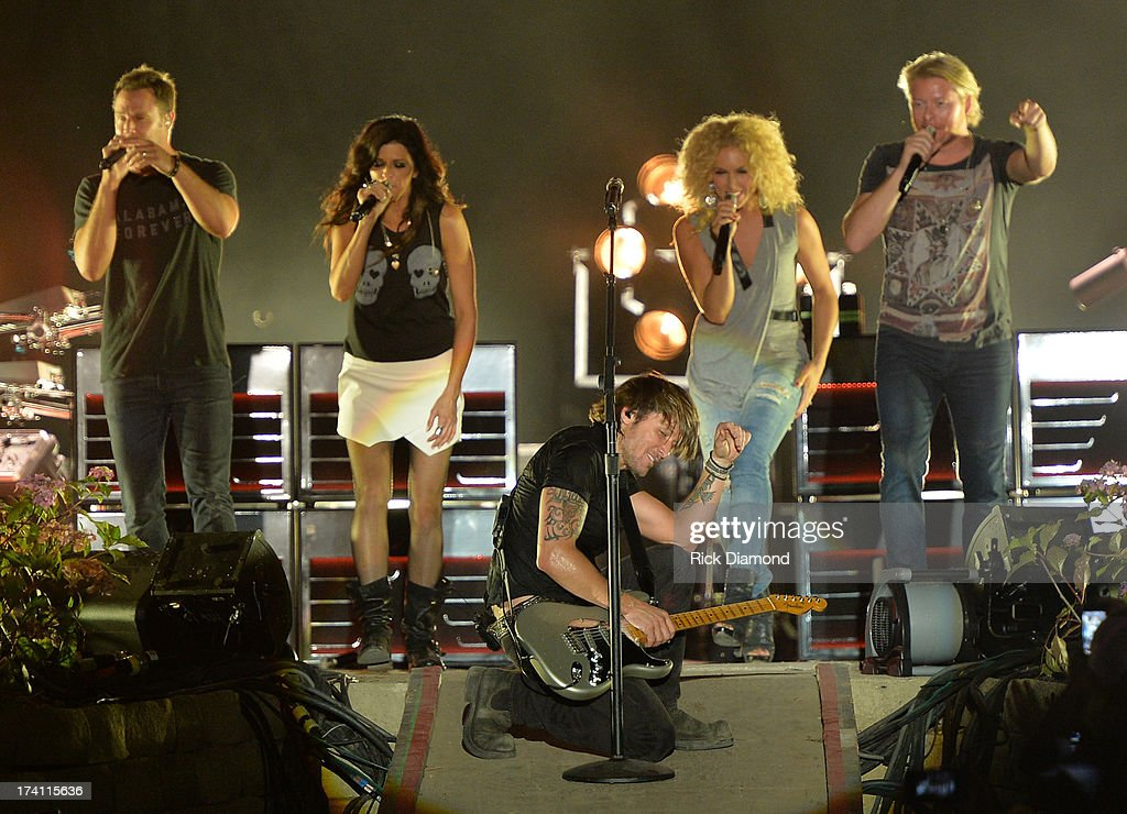 Little Big Town joins <a gi-track='captionPersonalityLinkClicked' href=/galleries/search?phrase=Keith+Urban&family=editorial&specificpeople=202997 ng-click='$event.stopPropagation()'>Keith Urban</a> (center) and performs at Country Thunder - Twin Lakes, Wisconsin - Day 2 on July 19, 2013 in Twin Lakes, Wisconsin.