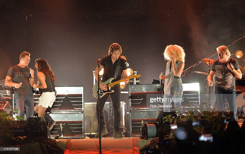 Little Big Town joins Keith Urban (center) and performs at Country Thunder - Twin Lakes, Wisconsin - Day 2 on July 19, 2013 in Twin Lakes, Wisconsin.