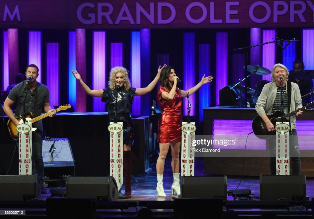 Jimi Westbrook, Kimberly Schlapman, Karen Fairchild and Phillip Sweet perform during Grand Ole Opry Total Eclipse 2017 Special Sunday Night Show at Grand Ole Opry House on August 20, 2017 in Nashville, Tennessee.