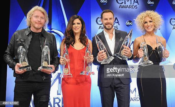Little Big Town poses in the press room at the 49th annual CMA Awards at the Bridgestone Arena on November 4 2015 in Nashville Tennessee
