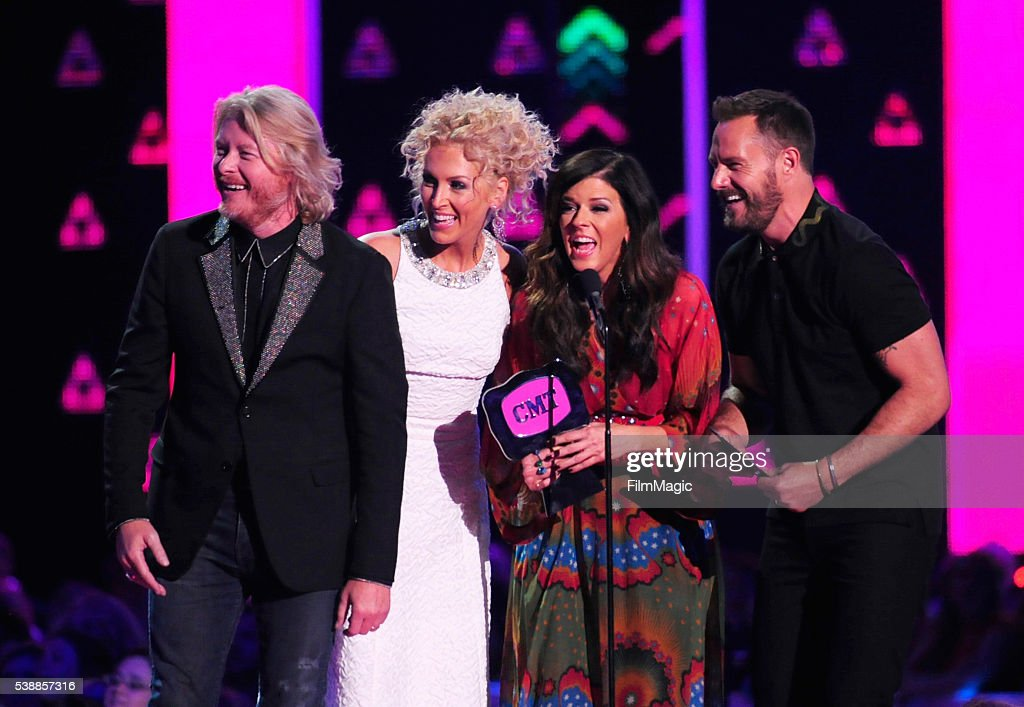 Little Big Town's Phillip Sweet Kimberly Schlapman Karen Fairchild and Jimi Westbrook accept an award onstageduring the 2016 CMT Music awards at the...