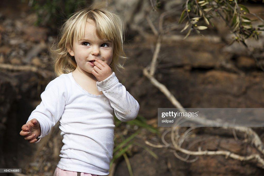 Little blonde girl smiling : Stock Photo