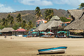 Little boat on the beach at this popular tourist hub for the southern surf coast, San Juan del Sur, Rivas Province, Nicaragua, Central America
