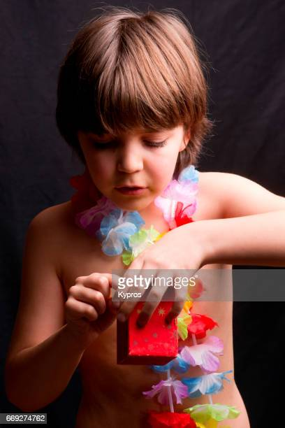 Little Boy Age 8 Years Doing Magic Tricks