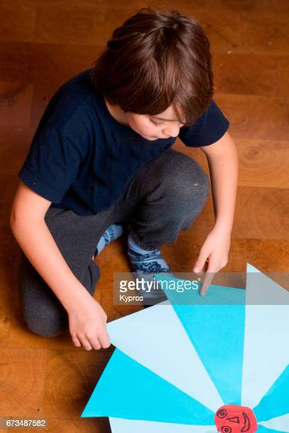 Little Boy Age 8 Years Making Paper Kite