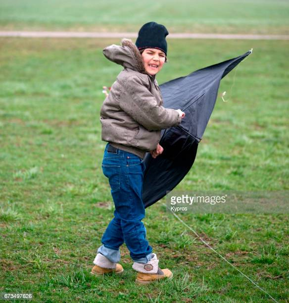 Little Boy Age 8 Years Playing With Kite