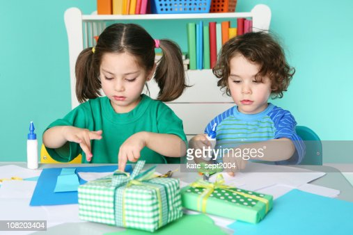 Little Boy and Girl Doing Crafts : Stock Photo