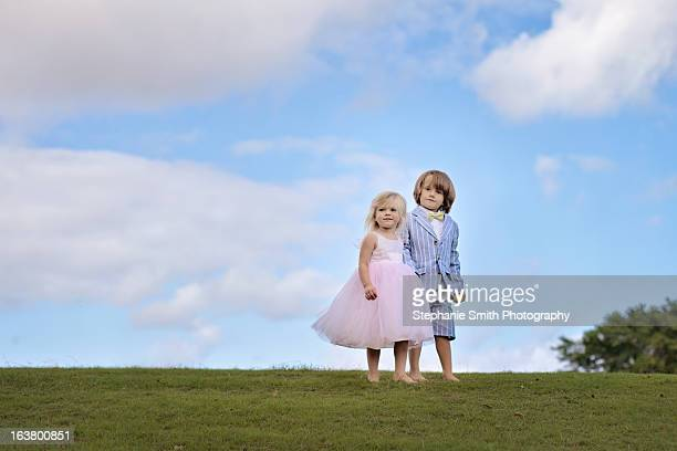 Little Boy and Girl Dressed Up on a Hill