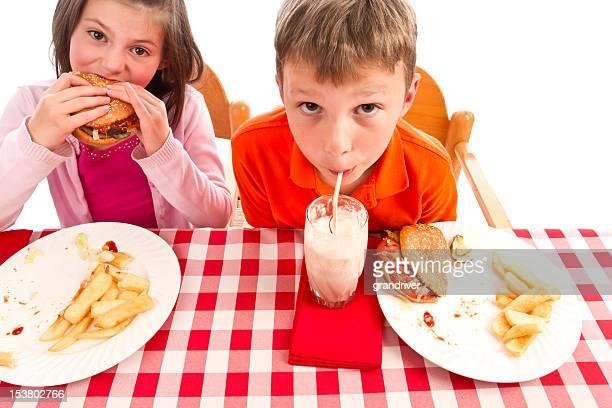 Little Boy and Girl Eating Cheeseburgers