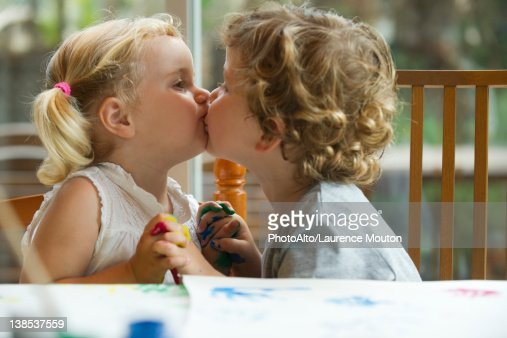 a boy and a girl kissing without dress