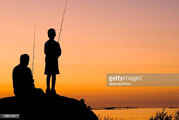 Little Boy And His Grandfather Fishing At Sunset - I