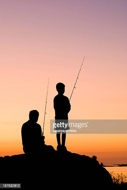 Little Boy And His Grandfather Fishing At Sunset - II