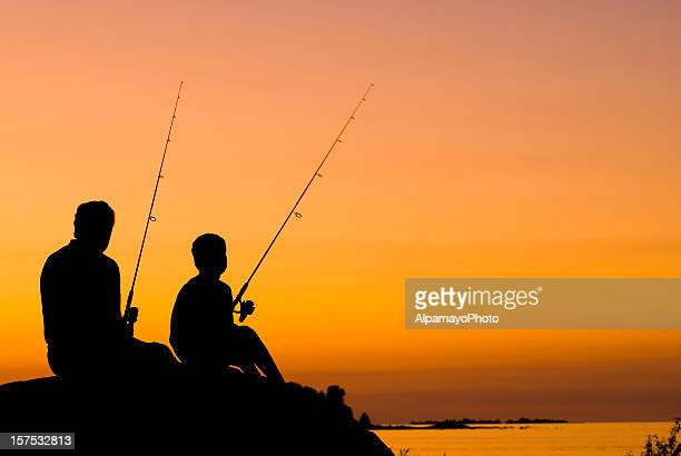 Little Boy And His Grandfather Fishing At Sunset - III