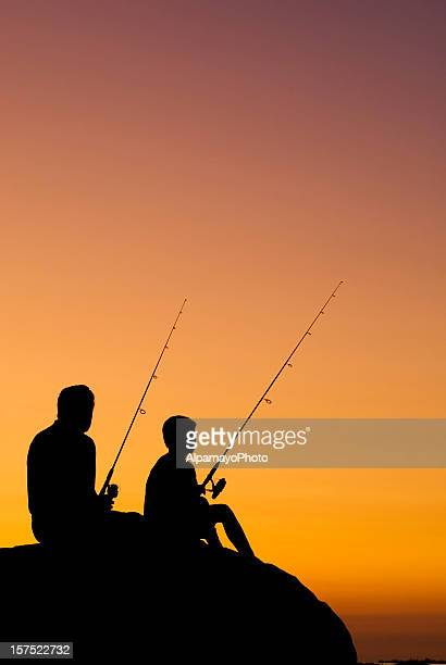 Little Boy And His Grandfather Fishing At Sunset - V