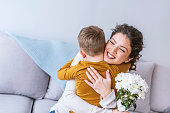 Little boy and Mother Happy Together. Boy Gift Mother Flowers. Love with Mother and Son. Care Boy with Mom. Romantic Day Happiness and Mother Happy that Gift Flowers. Happy Holiday 8 Marth.