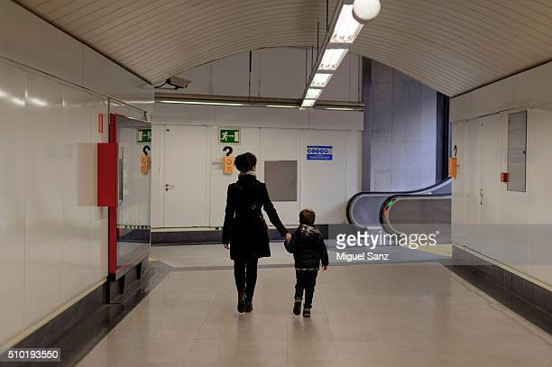 Little boy and mother walking in the underground