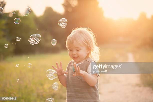 Little boy and soap bubbles