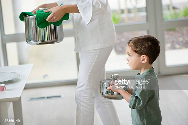 Little boy assisting his mother in serving food
