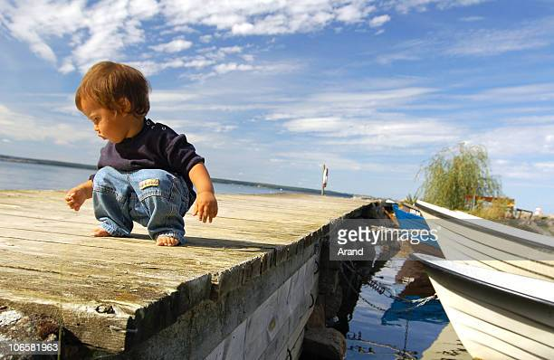 little boy  at pier