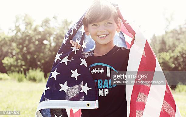Little boy being patriotic with a flag