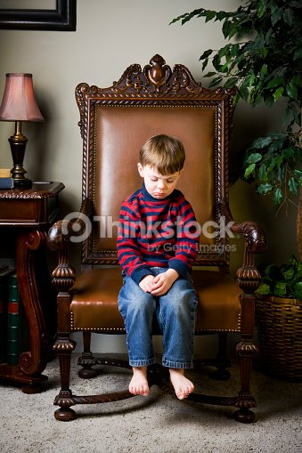 Little Boy Being Punished In Timeout Chair Stock Photo Thinkstock