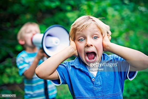 Little boy being yelled on by his brother
