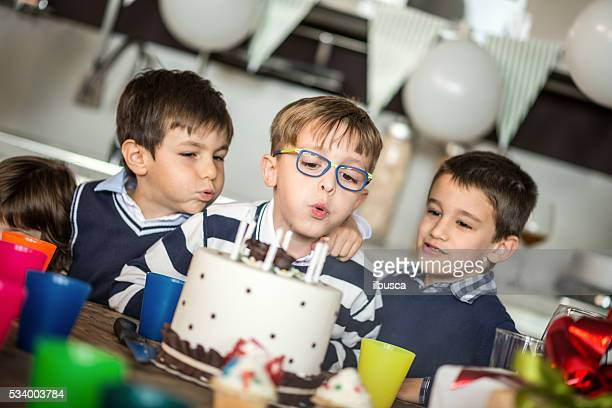 Little boy birthday party: blowing out candles