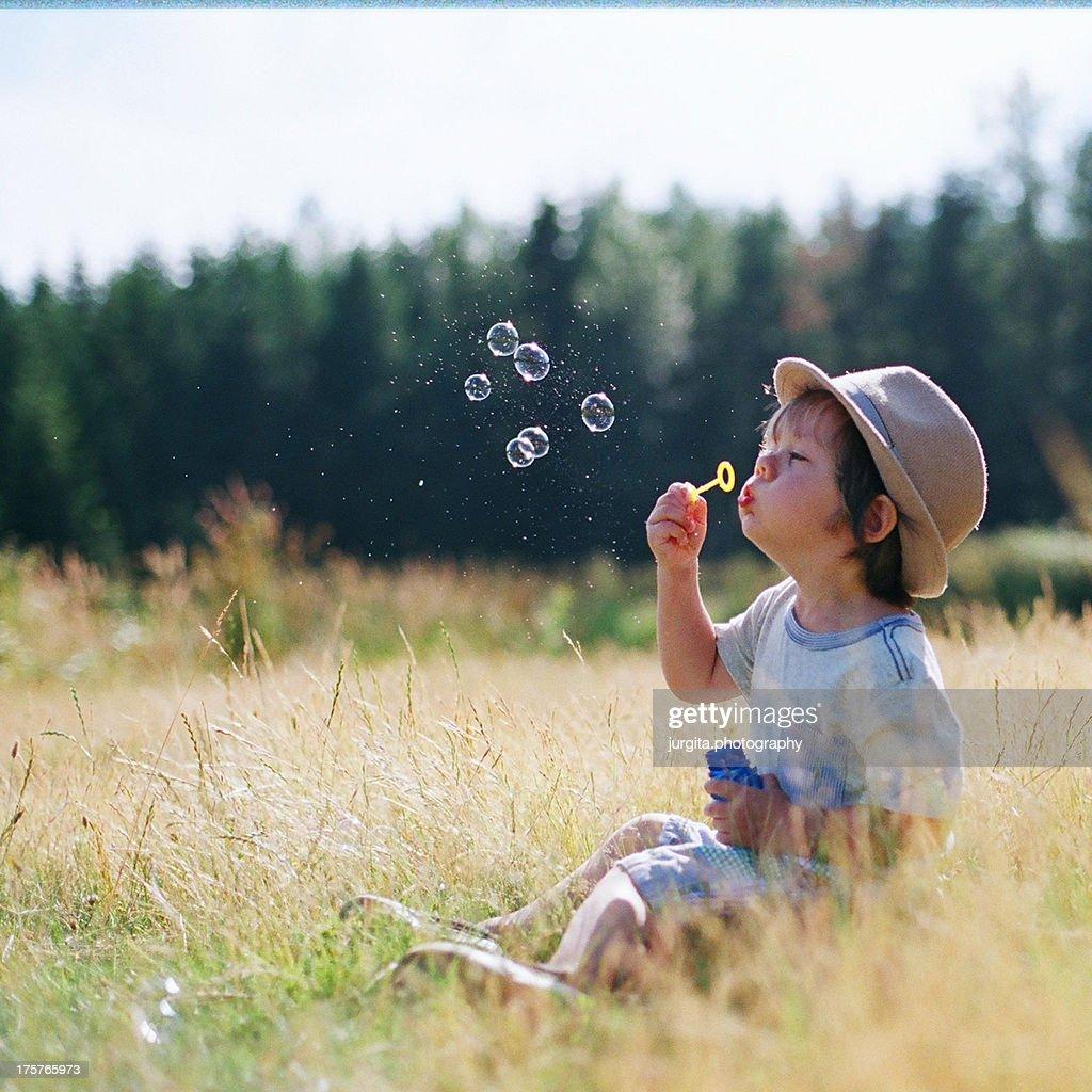 Little boy blowing bubbles
