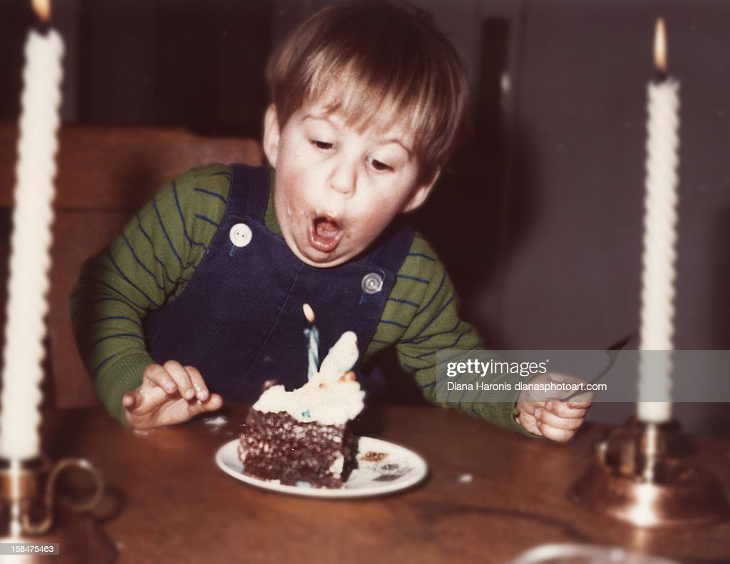 little boy blowing out his first birthday candle : Stock Photo