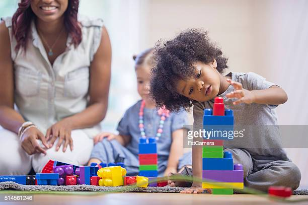 Little Boy Building a Tower