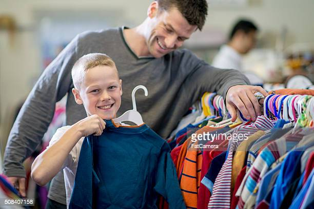Little Boy Buying a Shirt