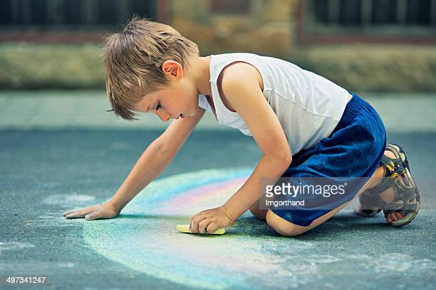 Little boy chalking