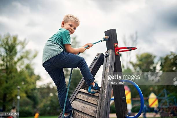 Little boy climbing on the playground