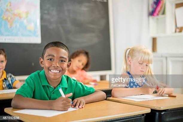 Little Boy Coloring in School