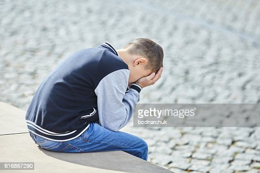 little boy crying on the street : Stock Photo