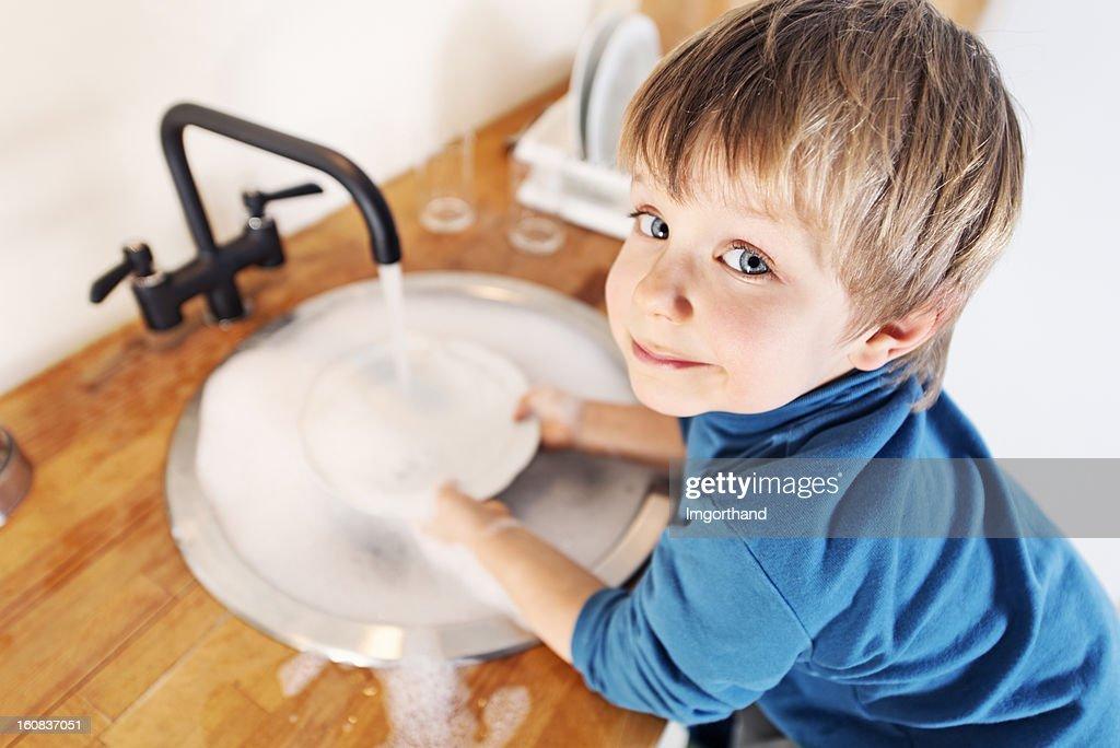 Little boy dishwashing : Stock Photo