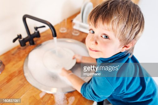 Little boy dishwashing : Stock Photo