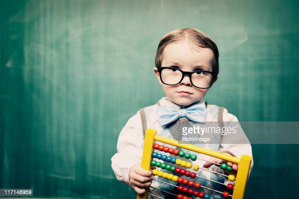 Little Boy Dressed as Acccountant using Abacus