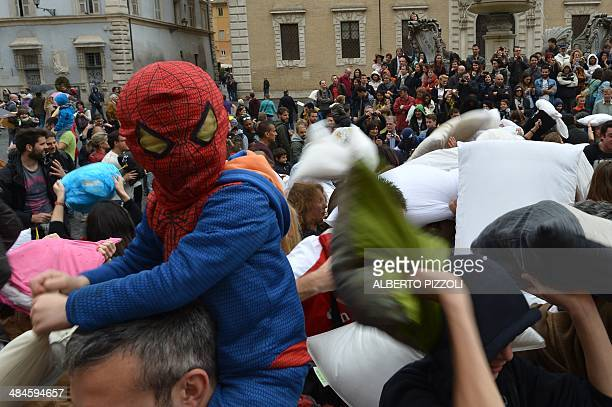 A little boy dressed as super hero 'Spiderman' takes part in a 'pillow fight' on April 13 2014 in Rome AFP PHOTO / ALBERTO PIZZOLI