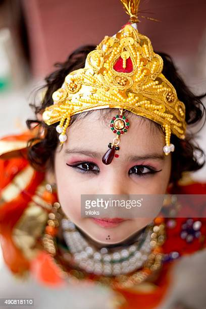 Little boy dressed up as Krishna
