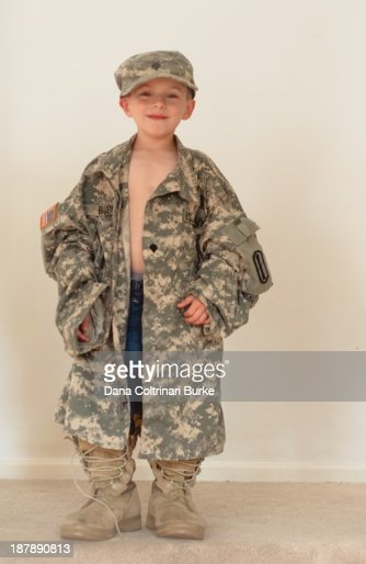 Little Boy Dresses Up In Dads Us Army Uniform Stock Photo