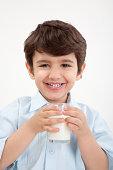 Little boy drinking glass of milk